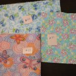 fabric choices: blue floral, pink flowers on blue, purple with butterflies
